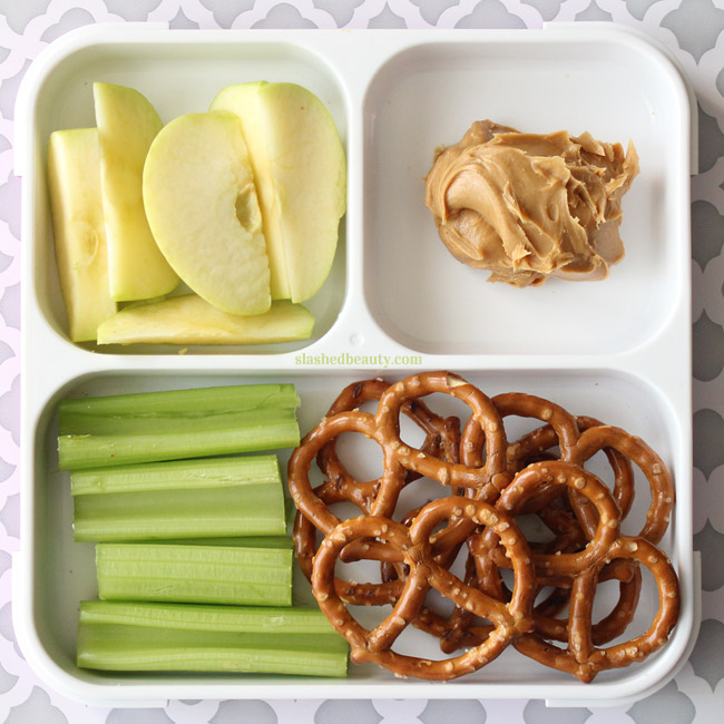 Need some healthy snack inspiration for work or school? Here are three snack pack ideas that will keep you full and on track with your fitness goals! Apple Slices, Celery, Pretzels & Peanut Butter | Slashed Beauty