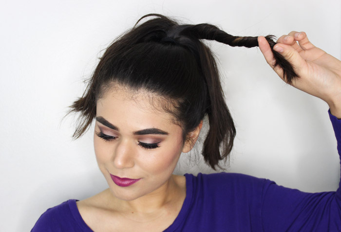 Switch things up with this twisted topknot hair tutorial. See the post for the step-by-step photos! | Slashed Beauty