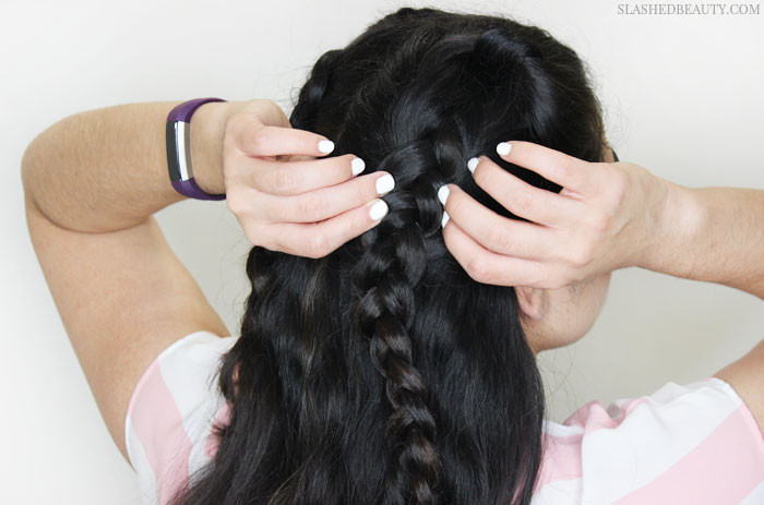 This half-up dutch braid tutorial is perfect for the warmer weather while keeping hair flowing in the breeze. See the step-by-step tutorial! | Slashed Beauty
