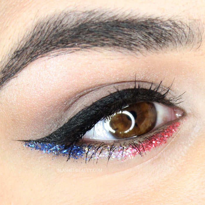 Take inspiration from this makeup for Fourth of July and add a little American spirit to your look with red, white and blue glitter. | Slashed Beauty