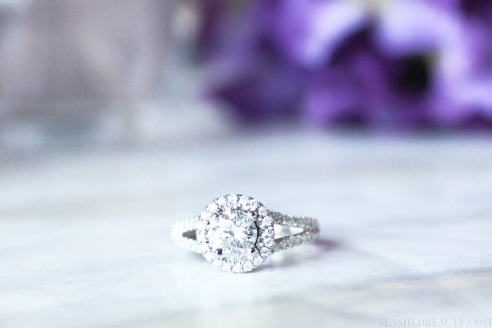 Halo engagement rings are definitely in style, but they're more than just a fad. Find out why I chose the halo style for my own engagement ring. | Slashed Beauty