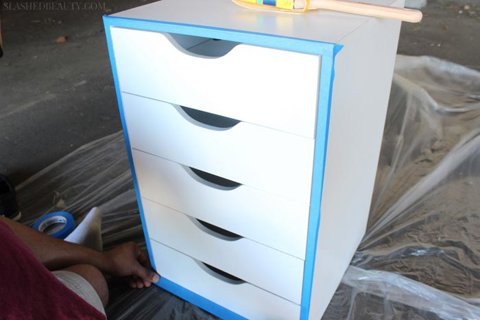 See how to easily transform white makeup drawers into a bold statement with this easy paint project. | Slashed Beauty