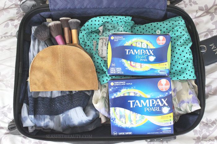 Are you nervous about traveling on your period? Here are 7 must-haves to pack to ensure a comfortable vacation during your time of month. | Slashed Beauty