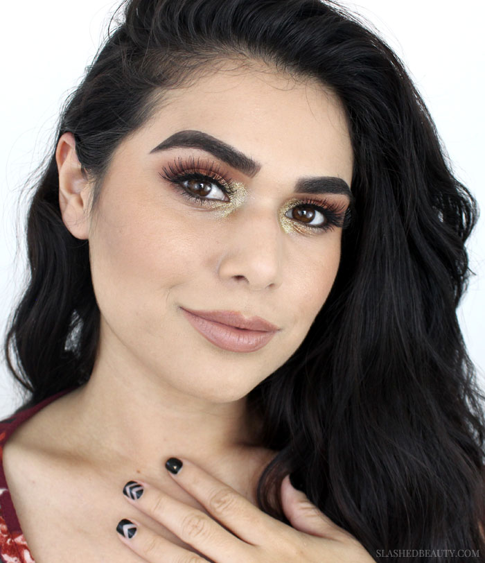 Peep this fall eyeshadow inspiration, using warm shades and gold glitter perfect for a concert festival! Watch the full fall eyeshadow tutorial.   Slashed Beauty