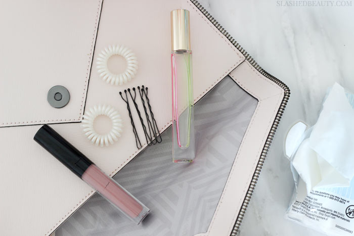 See what wedding day essentials I'm packing in my wedding clutch. I'm one prepared bride! | Slashed Beauty