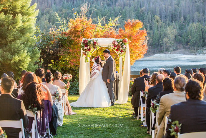 Jewish Fall Wedding Outdoors: See more wedding photos from this red fall wedding at Bass Lake (The Pines Resort). | Slashed Beauty