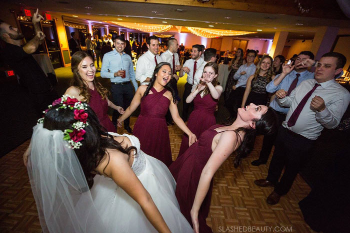 Bridesmaids Dancing: See more wedding photos from this red fall wedding at Bass Lake (The Pines Resort). | Slashed Beauty