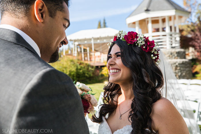 Bride's Face During First Look: See more wedding photos from this red fall wedding at Bass Lake (The Pines Resort). | Slashed Beauty
