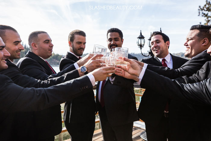 Groomsmen Cheers: See more wedding photos from this fall wedding at Bass Lake (The Pines Resort). | Slashed Beauty