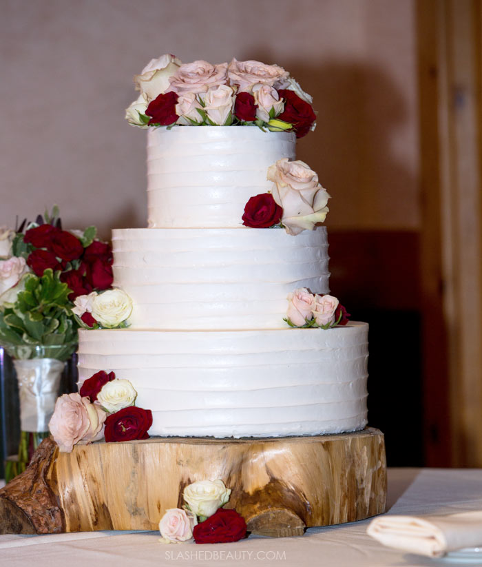 Fall Wedding Cake with Flower Topper: See more wedding photos from this red fall wedding at Bass Lake (The Pines Resort). | Slashed Beauty