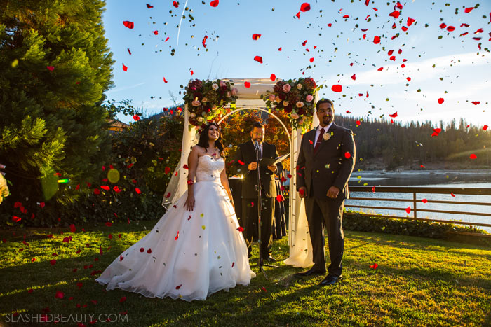 Flower Petal Toss: See more wedding photos from this red fall wedding at Bass Lake (The Pines Resort). | Slashed Beauty