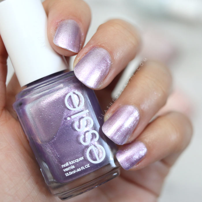 essie World Is Your Oyster: Shimmery lilac nail polish. See swatches of the 2018 essie Seaglass Shimmers collection! | Slashed Beauty