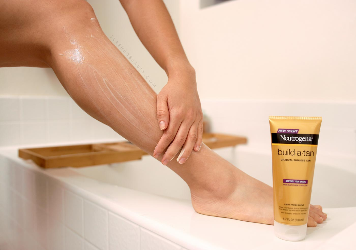 Applying Neutrogena Build-A-Tan lotion to the legs | Best Drugstore Self Tanner | Slashed Beauty