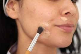 Using a blending brush to apply concealer over acne | How to Color Correct: Best Drugstore Makeup to Cover Acne | Slashed Beauty