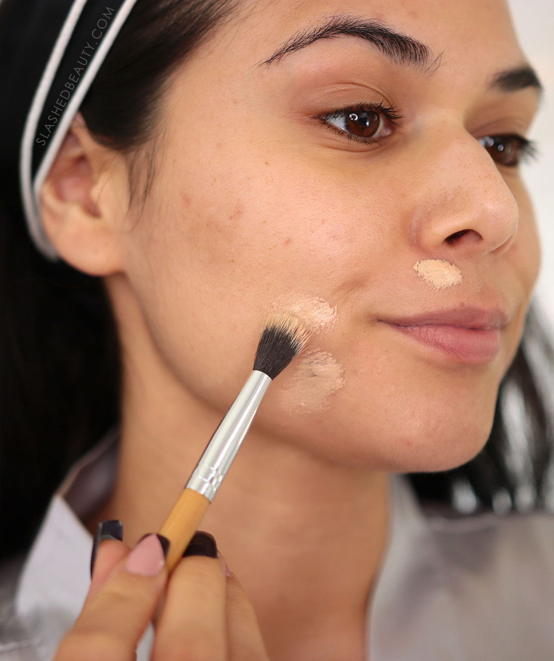 Using a blending brush to apply concealer over acne   How to Color Correct: Best Drugstore Makeup to Cover Acne   Slashed Beauty