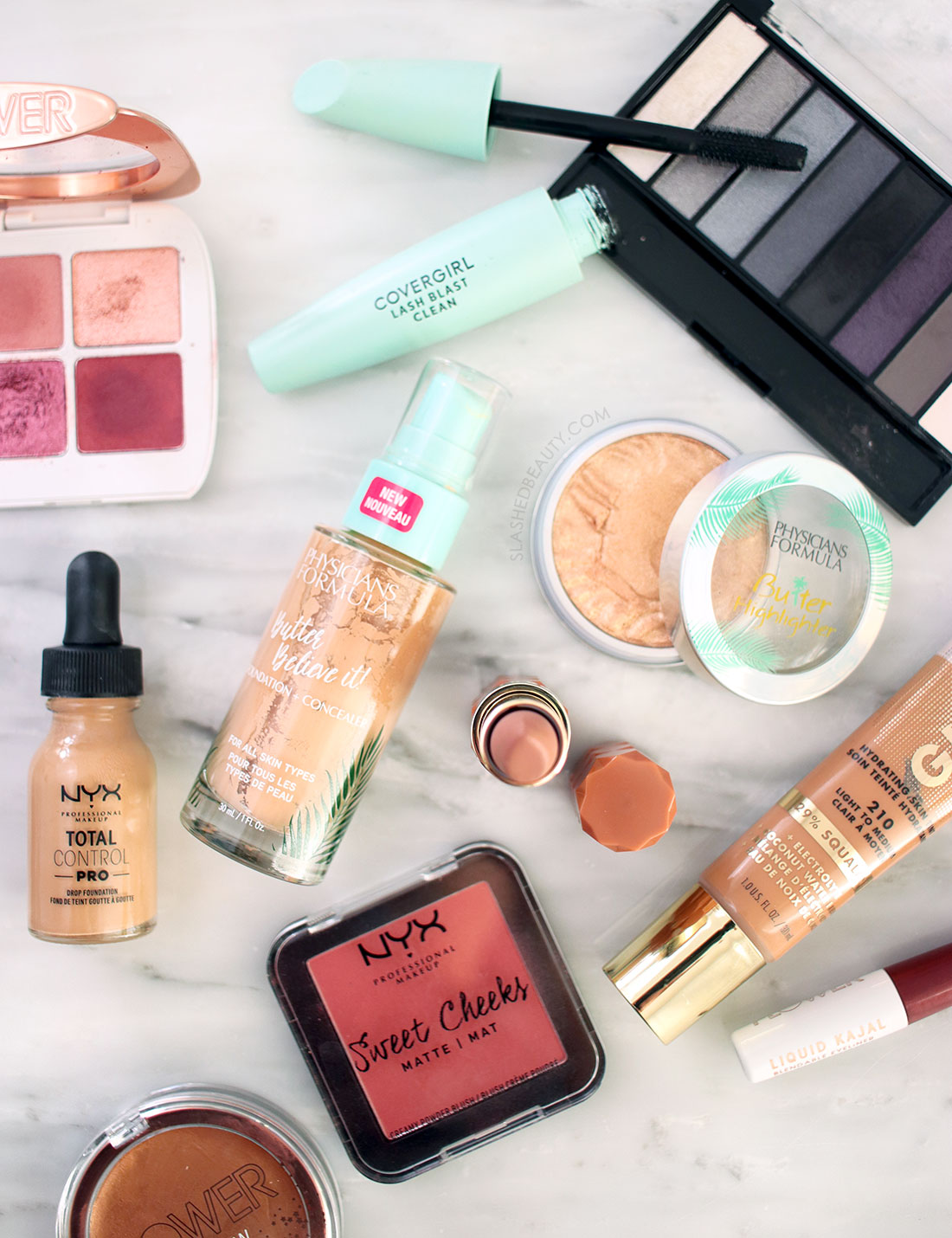Various cruelty free drugstore makeup products lying flat on a marble surface   My 5 Favorite Cruelty Free Drugstore Makeup Brands   Slashed Beauty